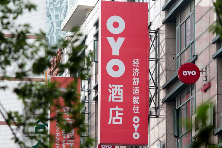 More than 20 laid-off OYO employees traveled to the company's Shanghai headquarters to demand back pay on March 9. Photo: IC Photo