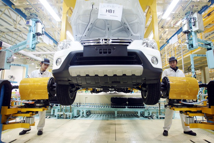 Workers assemble a car at a factory in Wuhan, Central China's Hubei province. Photo: IC Photo