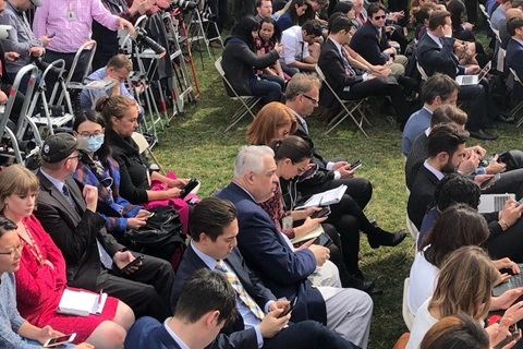 Reporters await a press conference in the White House Rose Garden on Friday afternoon. Photo: Zhang Qi/Caixin