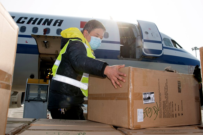 On Feb. 9, staff at Wenzhou Longwan International Airport unload epidemic supplies donated by overseas Chinese in Brazil. Photo: Xinhua