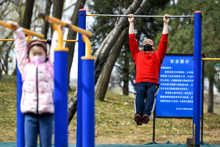 People exercise at a Beijing park on March 12. Photo: IC Photo