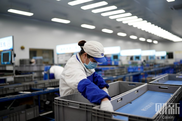 Hubei's epidemic control center announced on March 11 that the province will classify every county as a low-, middle- or high-risk zone, allowing companies to reopen and restart production based on their location. Photo: Ding Gang/Caixin