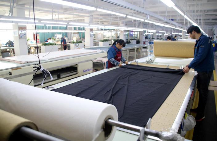 Workers at clothing factory in Suzhou, Jiangsu province, Jan. 9. Photo: VCG