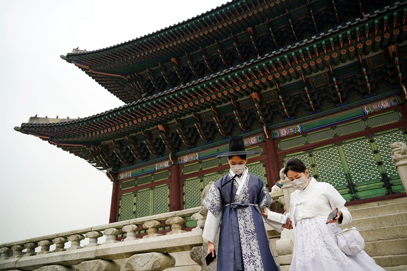 Tourists in traditional Korean hanbok wearing masks at the Gyeongbokgung Palace in Seoul March 1.