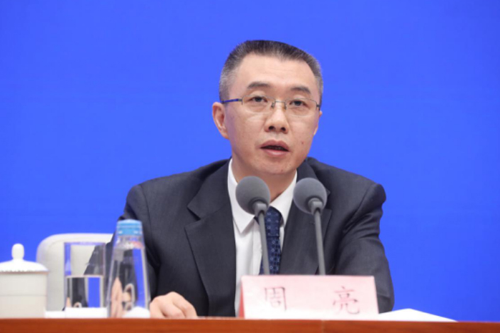 Zhou Liang, a vice chairman of the China Banking and Insurance Regulatory Commission, speaks at a press conference Sunday. Photo: CBIRC