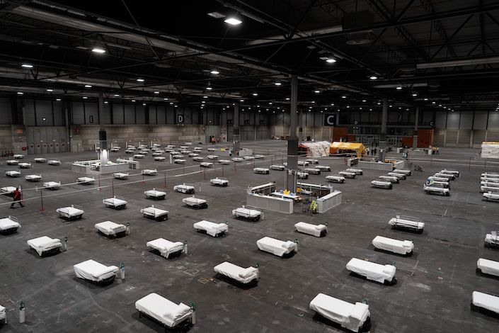A makeshift hospital set up at Ifema exhibition complex in Madrid, Spain, with 5,500 beds. Photo: Bloomberg
