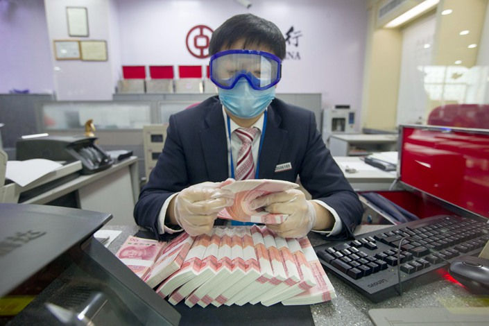 The proceeds from the special treasury bonds could be spent on infrastructure and on bailing out small and midsize companies, analysts said. Photo: People.VCG