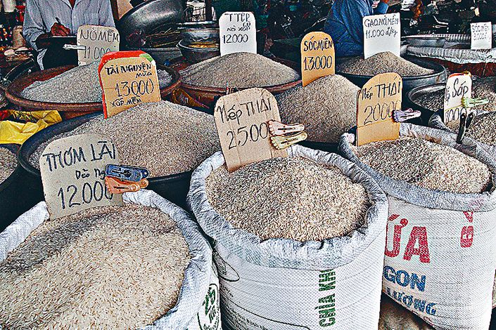 Rice for sale at a market near the Mekong river in Vietnam. Photo: VCG
