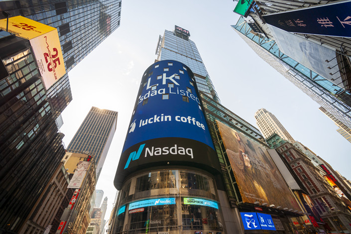 The giant video screen on the Nasdaq stock exchange in New York's Times Square is decorated for the Luckin Coffee initial public offering on Friday, May 17, 2019. Photo: IC Photo