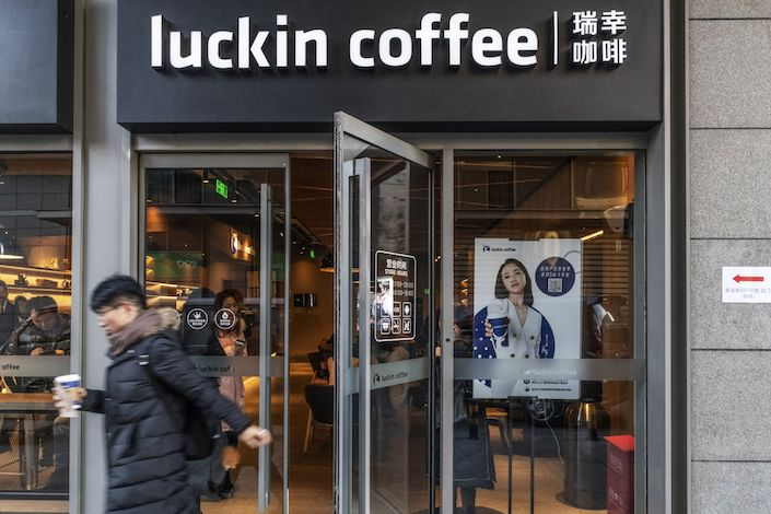 A customer exits a Luckin Coffee outlet in Beijing
