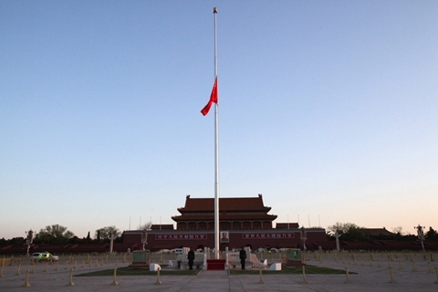 China's national flag flies at half-staff Saturday in Tiananmen Square in Beijing to honor the victims of the coronavirus. Photo: IC Photo