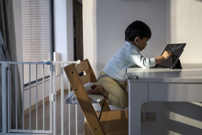 A child takes online class at home. Photo: Bloomberg