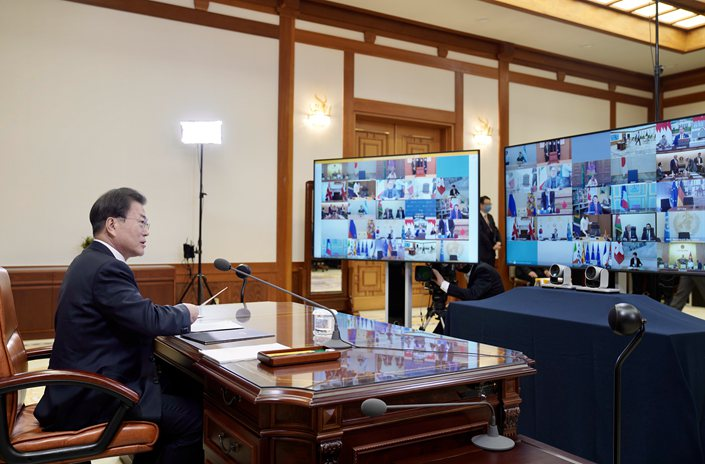 South Korean President Moon Jae-in attends a G-20 virtual summit to discuss the coronavirus outbreak at the presidential Blue House in Seoul, South Korea, on March 26.