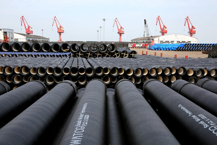 Steel pipes sit stacked at the port of Lianyungang, East China's Jiangsu province, on Feb. 27.