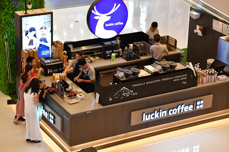 Customers pick up their orders at a Luckin store in Shanghai.