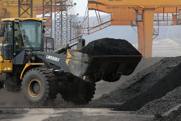 Coal is transported at a railway freight yard in Suifenhe, Heilongjiang province, on April 19.