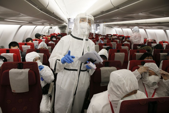 Passengers on a plane at Xi'an Xianyang international airport on April 1.