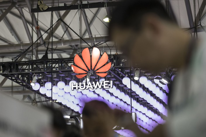 Signage is displayed at the Huawei Technologies Co. booth at the MWC Shanghai exhibition in Shanghai on June 27, 2019. Photographer: Bloomberg