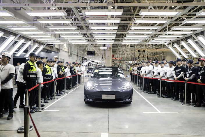 A Tesla Model 3 vehicle set to be delivered to a company employee moves off an assembly line during a ceremony at the company's Gigafactory in Shanghai. Photo: Bloomberg
