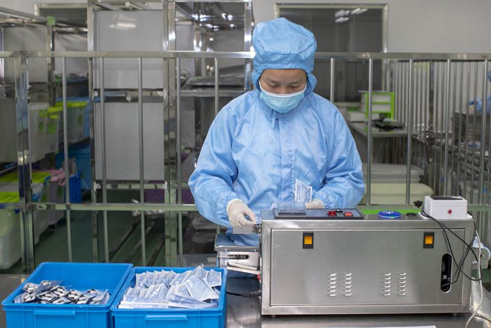 On April 9, a worker packs Covid-19 detection reagents produced by a biotechnology company in Taizhou, Jiangsu province.