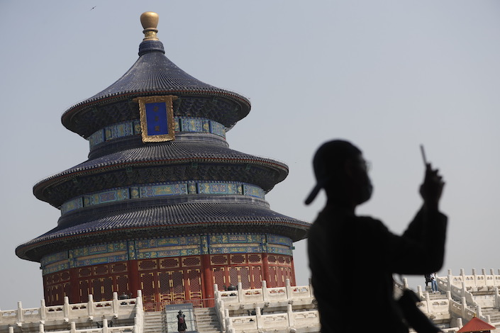 A visitor takes photo at the Temple of Earth in Beijing on April 29. Photo: IC