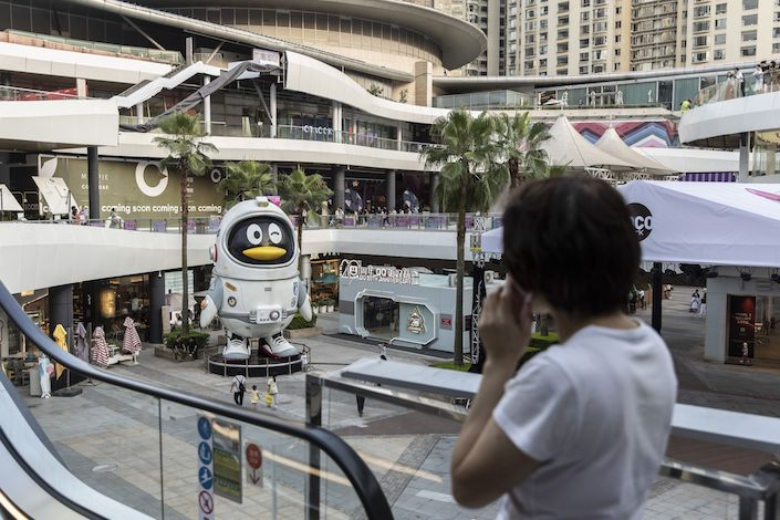 A Tencent Holdings Ltd.'s QQ penguin mascot stands in Shenzhen