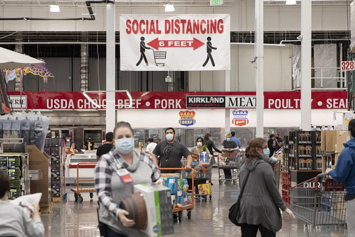A San Francisco, California, displays a sign that reminds customers to socially distance on May 3.