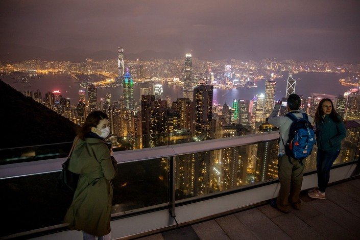 People look at the city's skyline from a viewing terrace at Victoria Peak in Hong Kong on Feb. 3. Photo: Bloomberg
