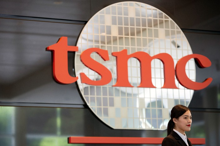 Signage for Taiwan Semiconductor Manufacturing Co. is displayed at the company's headquarters in Hsinchu, Taiwan, on June 5, 2019. Photo: Bloomberg