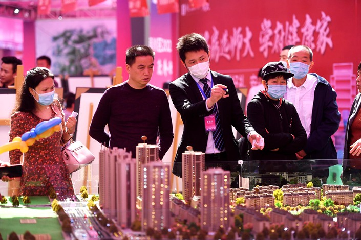 People shop for property at a housing fair in Chongqing on May 1.