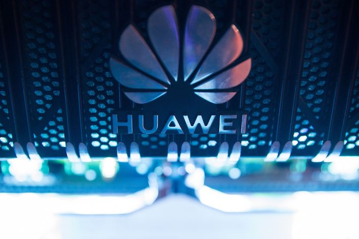 A corporate logo sits on a Huawei Technologies Co. NetEngine 8000 intelligent metro router on display during a 5G event in London. Photo: Bloomberg
