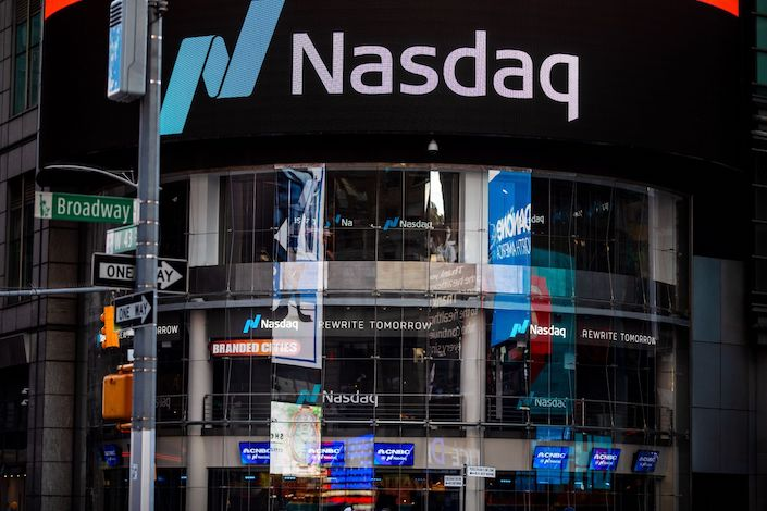 Signage is displayed outside the Nasdaq Market Site in the Times Square area of New York. Photo: Bloomberg