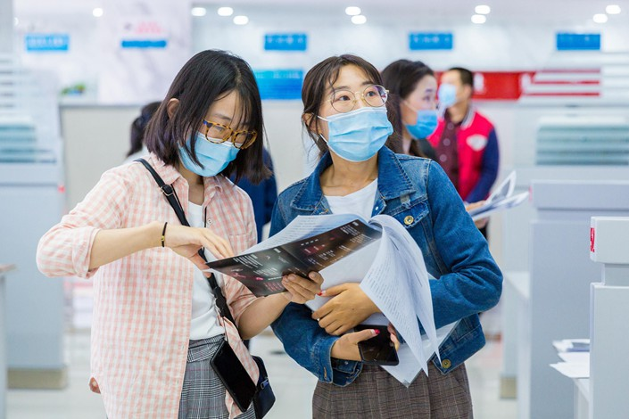 College graduates attend a job fair in Hohhot, Inner Mongolia, on May 20.