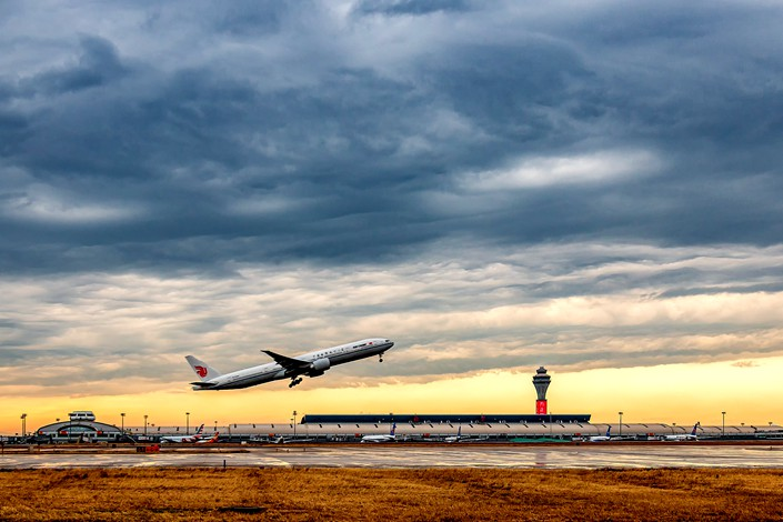A flight takes off from Beijing Capital International Airport on Oct. 24.