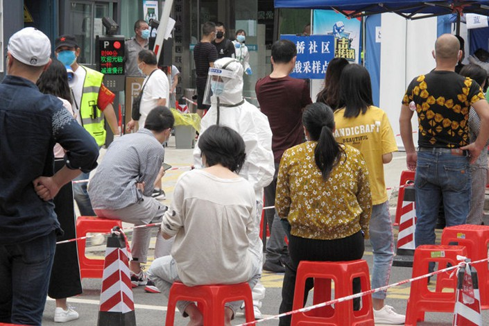Wuhan residents line up to be tested for Covid-19 on Wednesday.