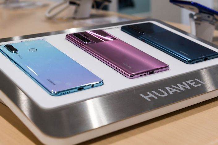 The Huawei P30 Lite and P30 Pro smartphones are displayed at the Huawei store in Brussels. Photo: Bloomberg