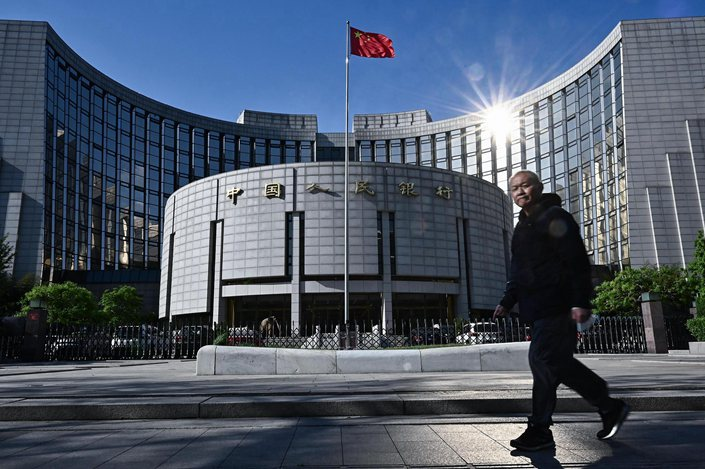 A pedestrian walks past the People's Bank of China in Beijing on April 20.