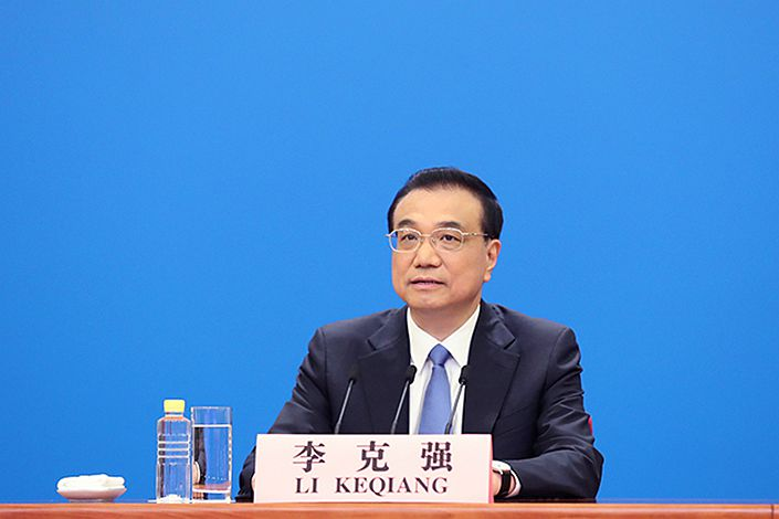 Premier Li Keqiang answers questions at a press conference Thursday at the Great Hall of the People in Beijing. Photo: Xinhua