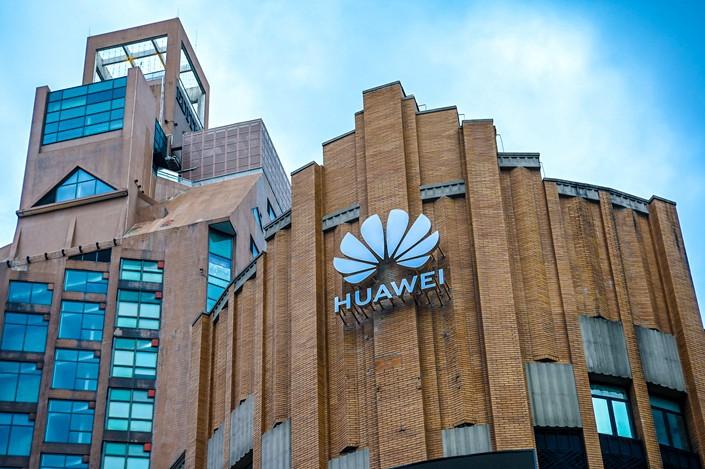 A Huawei logo along a Shanghai pedestrian street, May 23.