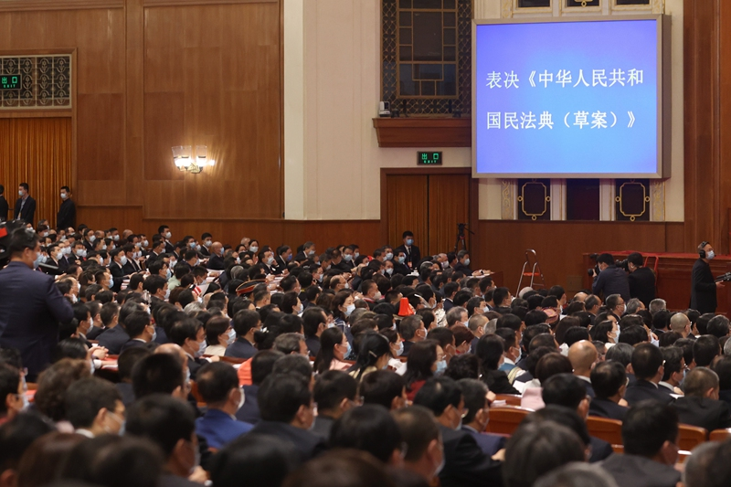 Of 2,886 national lawmakers, 2,879 voted May 28 in favor of China's new civil code.
