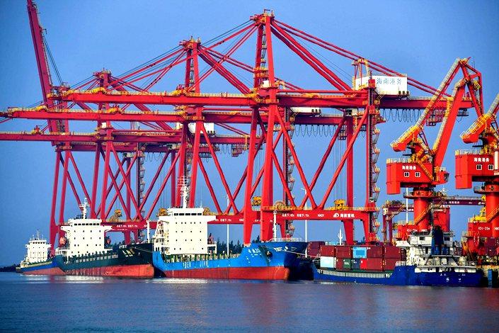Cargo ships dock at Yangpu Port in South China's Hainan province on Monday.