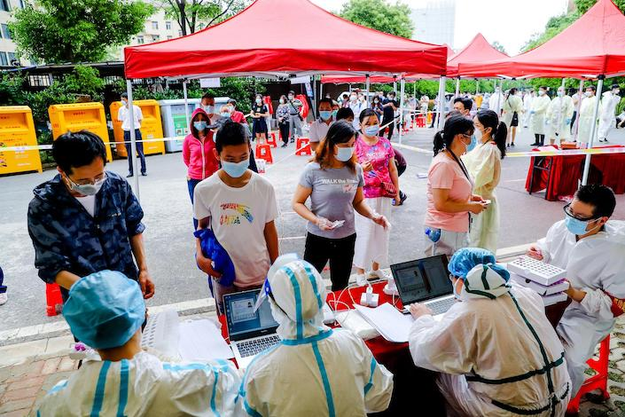 People line up to get nucleic acid testing May 16 in Wuhan.