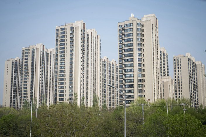 Residential buildings stand in the Taiyanggong area of Beijing in April 2018. Photo: Bloomberg