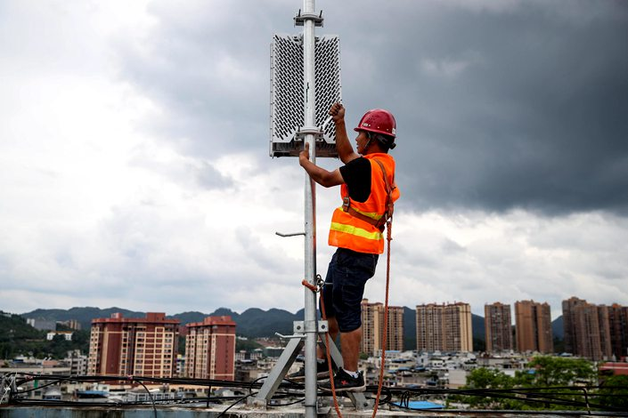 China Mobile workers install a 5G base station in Zunyi, Guizhou province, on May 26.