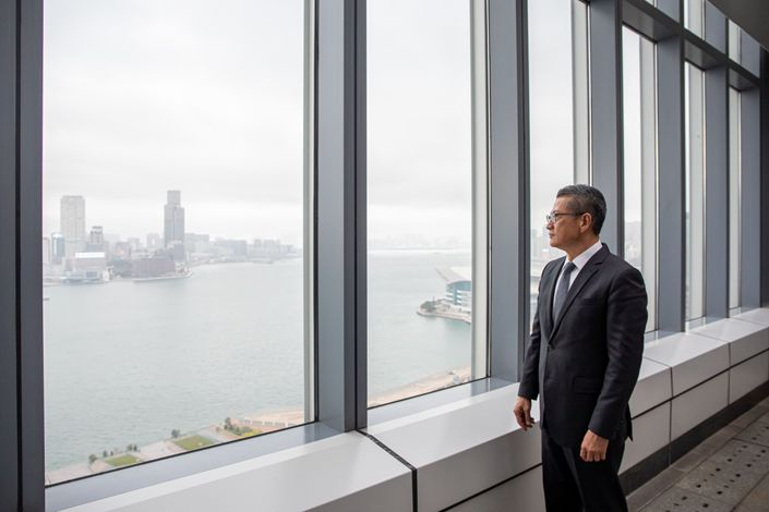 Paul Chan, Hong Kong's financial secretary, poses for a photograph following a Bloomberg Television interview in Hong Kong on March 2. Photo: Bloomberg