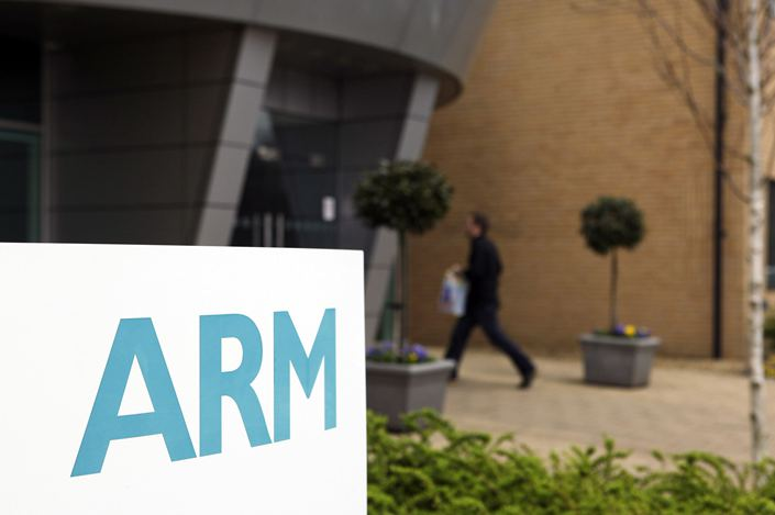 An employee enters the ARM Holdings Plc headquarters in Cambridge