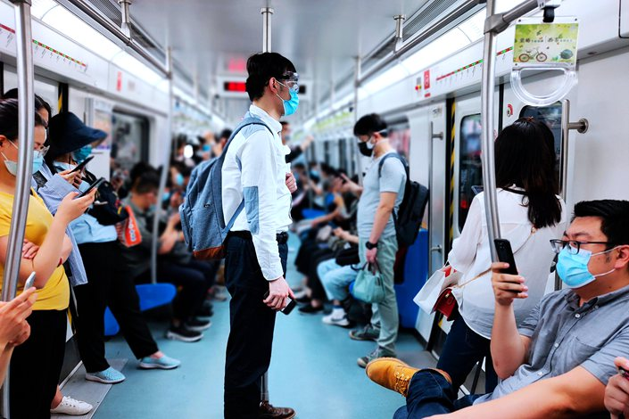 Passengers on Line 5 of Beijing subway wear face masks on May 29.
