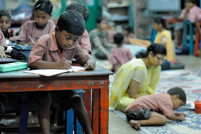 Children take classes provided by an NGO in Calcutta, India.