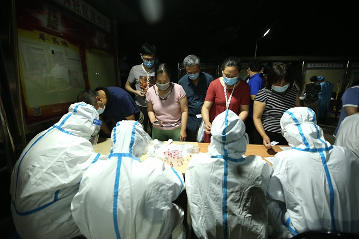 People get tested for the coronavirus near Bejiing's Xinfadi market on June 15.