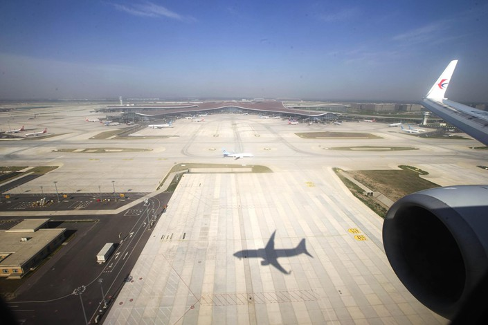 Beijing's airports grounded 40% of scheduled flights on Tuesday, according to figures compiled by airline data tracker VariFlight.